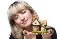 The business woman holds the small house i Royalty Free Stock Photo