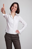 Business woman holds thumbs up Royalty Free Stock Photography