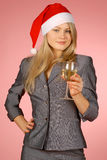 Business woman & holiday. The girl in a New Year's cap Stock Photo