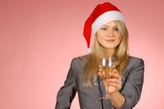 Business woman & holiday. The girl in a New Year's cap Royalty Free Stock Image