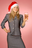 Business woman & holiday. The girl in a New Year's cap Royalty Free Stock Photography