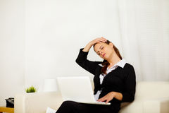 Business woman at home with neck pain Royalty Free Stock Photo