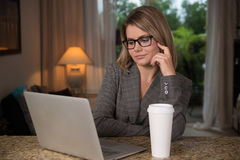 Business woman at home. Business woman working at home Stock Image