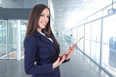 Business woman. Or hostess of congresses and meetings royalty free stock photo
