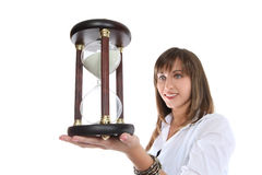 Business Woman with Hourglass. Young pretty businesswoman holding a hourglass isolated on white Royalty Free Stock Images