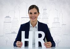 Business woman with HR letter against white wall with city doodle Royalty Free Stock Image