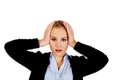 Business woman with a huge headache holding head Royalty Free Stock Photo