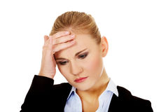 Business woman with a huge headache holding head Stock Image