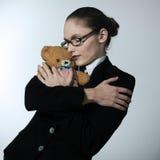 Business woman huging teddy bear Stock Photos