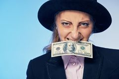 Business woman with a hundred dollars in her teeth. Young business woman with a hundred dollars in her teeth Stock Photo