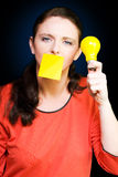 Business woman with idea holding yellow light bulb Stock Photos