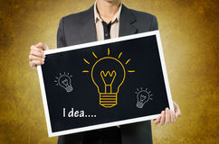 Business woman with idea light bulb icon in Black chalkboard on Royalty Free Stock Image