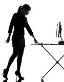 Business woman igniting computer computing  silhouette Stock Images