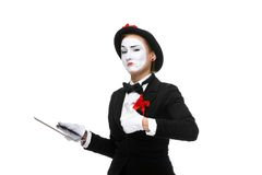Business woman in the image mime holding tablet PC Stock Images