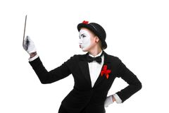 Business woman in the image mime holding tablet PC Royalty Free Stock Photography
