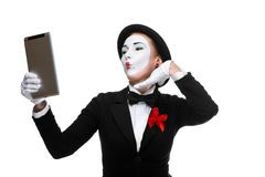 Business woman in the image mime holding tablet PC Stock Image
