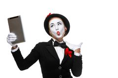Business woman in the image mime holding tablet PC Royalty Free Stock Image