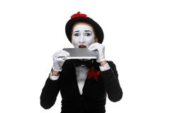 Business woman in the image mime holding tablet PC Royalty Free Stock Photos