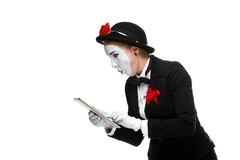 Business woman in the image mime holding tablet PC Royalty Free Stock Images
