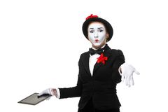 Business woman in the image mime holding tablet PC Stock Photos