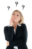 Business Woman In A Suit Having Questions. Royalty Free Stock Photo