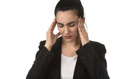 Business Woman In Office Suit Suffering Migraine Pain And Strong Headache With Fingers On Her Tempo Royalty Free Stock Photo