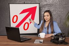 Business woman indicates a percentage increase royalty free stock photography