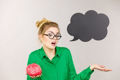 Business woman intensive thinking holding brain Stock Photography