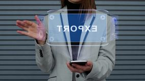 Business woman interacts HUD hologram Export. Unrecognizable business woman, interacts with a HUD hologram with text Export. Girl in a business suit uses the stock footage