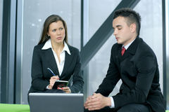 A business woman is interviewing her male colleagu Royalty Free Stock Photo
