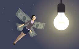 Business-woman investor with money-wings flying to. Funny concept metaphor - business-woman investor with money-wings flying to the lightbulb of startup idea Stock Image