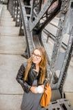 Business woman on the iron bridge Royalty Free Stock Image