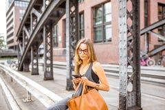 Business woman on the iron bridge Stock Photo