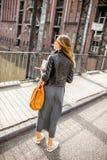 Business woman on the iron bridge Royalty Free Stock Photo