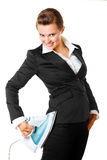 Business woman ironing her suit right on herself Royalty Free Stock Photography
