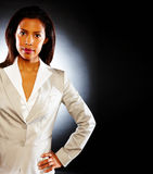 Business woman isolated over dark background Stock Photography