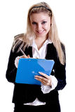 Business woman in a jacket with clipboard Royalty Free Stock Images