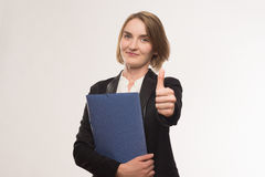 Business woman. In a jacket with a folder in hands Stock Photos