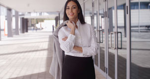 Business woman with jacket over shoulder Royalty Free Stock Photos