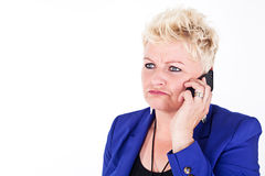 Business woman in jacket talking on the phone Stock Photo