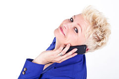Business woman in jacket talking on the phone Royalty Free Stock Images