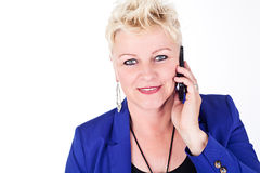 Business woman in jacket talking on the phone Stock Photography