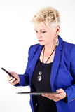 Business woman in jacket talking on the phone Royalty Free Stock Photos