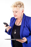 Business woman in jacket talking on the phone Royalty Free Stock Photo