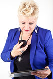 Business woman in jacket talking on the phone Royalty Free Stock Photography