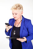 Business woman in jacket talking on the phone Stock Images