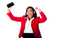 Business woman jamming listening to music. Beautiful happy business woman jamming singing listening to music on wireless mobile phone, on white Royalty Free Stock Photos