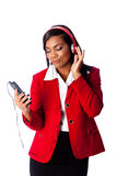 Business woman jamming listening to music. Beautiful happy business woman jamming listening to music on wireless mobile phone, on white Royalty Free Stock Photography
