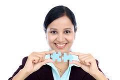 Business woman joining two jigsaw puzzle pieces Royalty Free Stock Photos