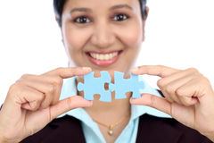 Business woman joining two jigsaw puzzle pieces Stock Image